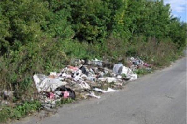 Краснинский район завален мусором